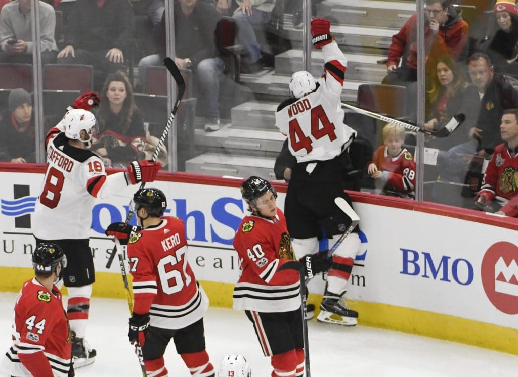 Wood hits hat trick as Devils catch fire to beat Blackhawks