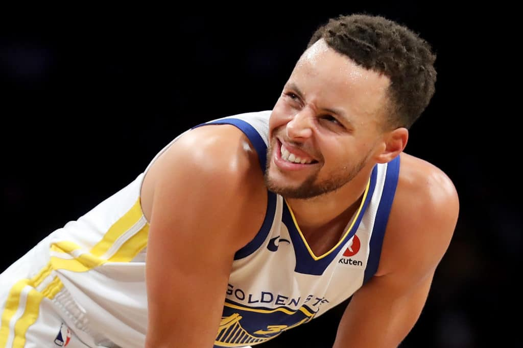 Curry drops 39, fouls out as Warriors hold off Nets comeback