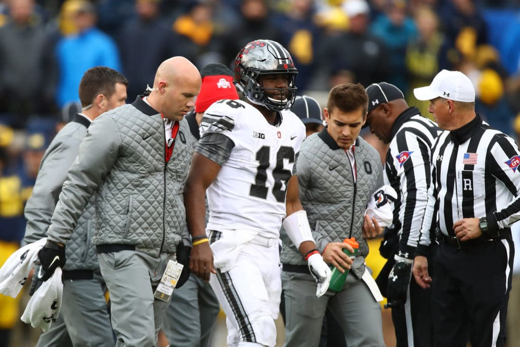 JT Barrett leaves MI game with knee injury
