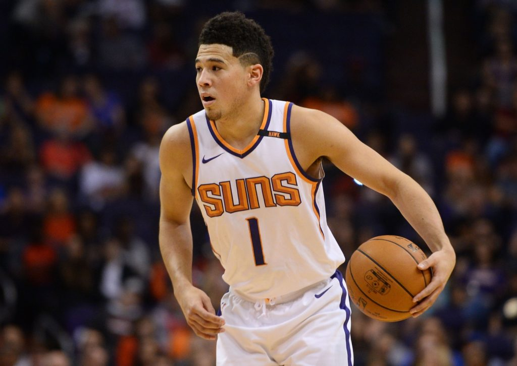 Suns Devin Booker carried off the court with leg injury