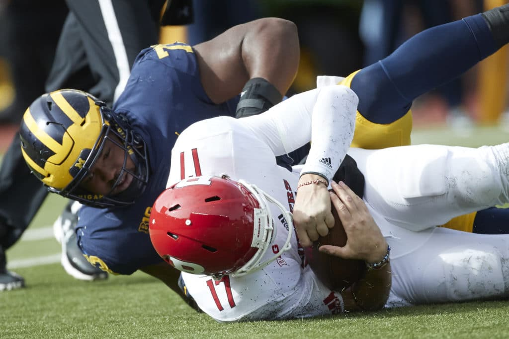 Oct 28, 2017; Ann Arbor, MI, USA; Rutgers Scarlet Knights quarterback Giovanni Rescigno (17) is sacked by Michigan Wolverines defensive lineman Maurice Hurst (73) in the first half at Michigan Stadium. Mandatory Credit: Rick Osentoski-USA TODAY Sports