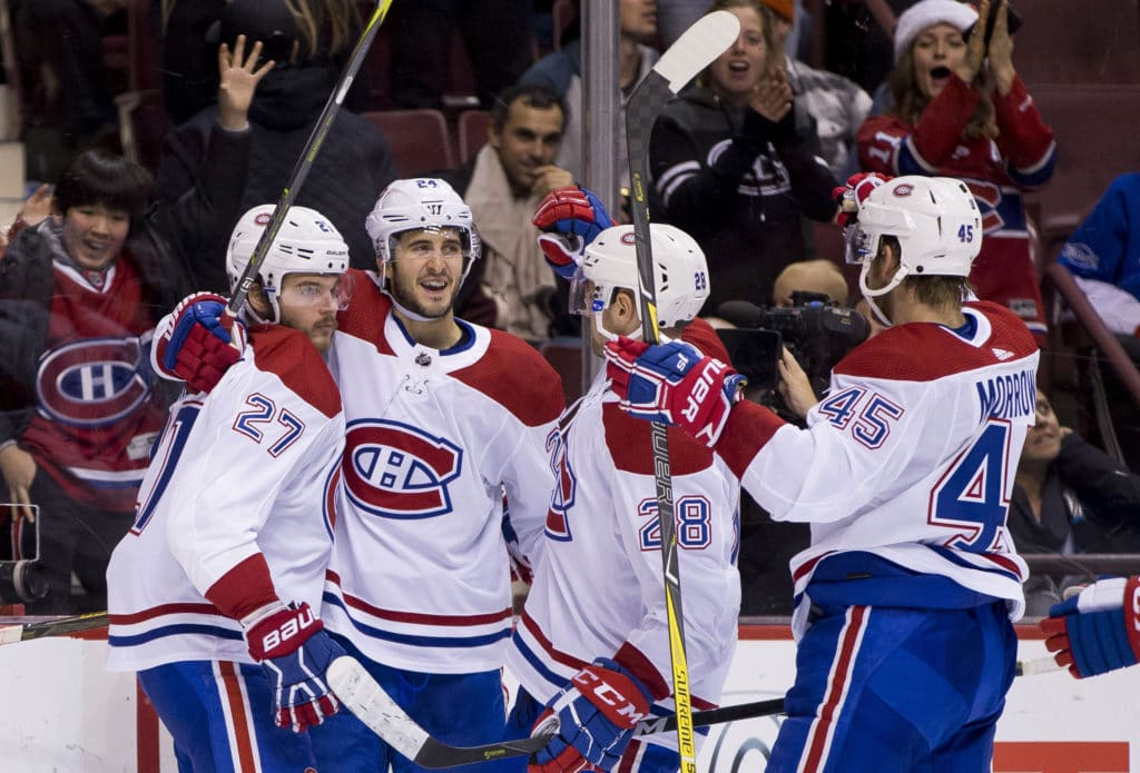 Canadiens down Canucks 7-5