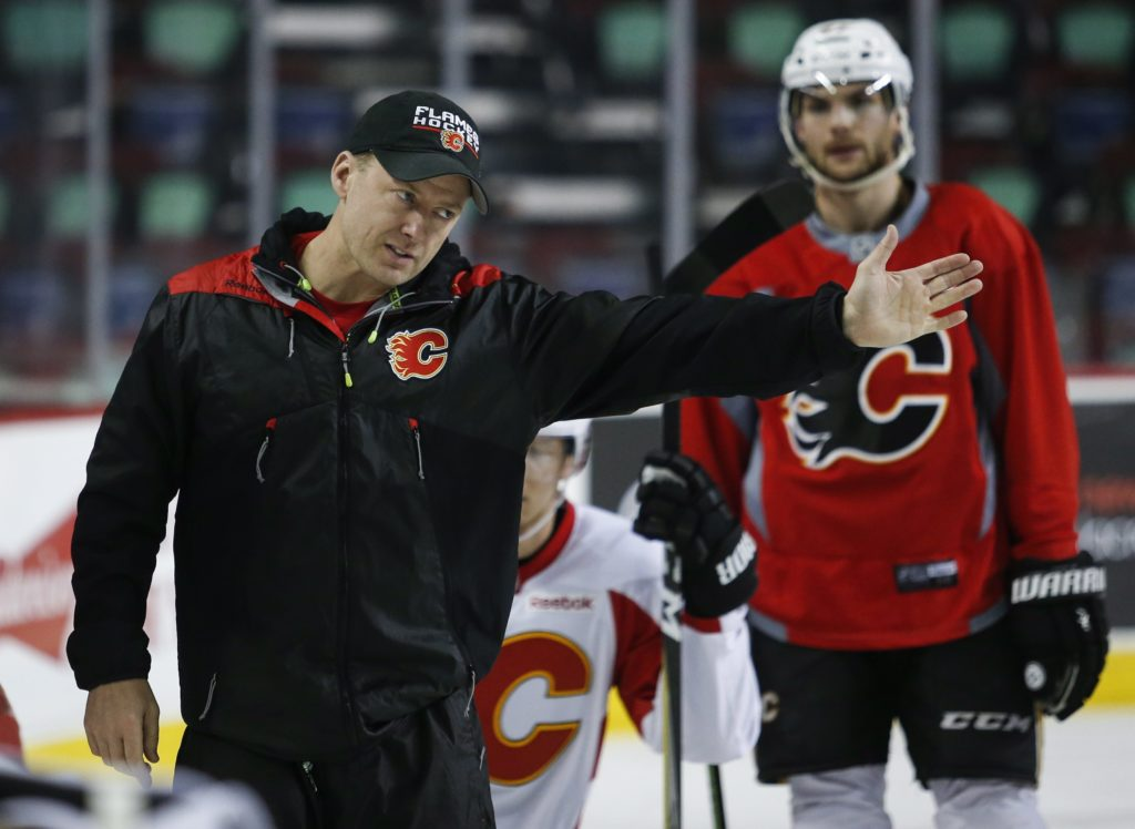 Calgary Flames' head coach Glen Gulutzan gestures during a team practice in Calgary, Alberta, Monday, April 10, 2017. The Flames will play the Anaheim Ducks in the first round of the NHL playoffs. (Jeff McIntosh/The Canadian Press via AP)