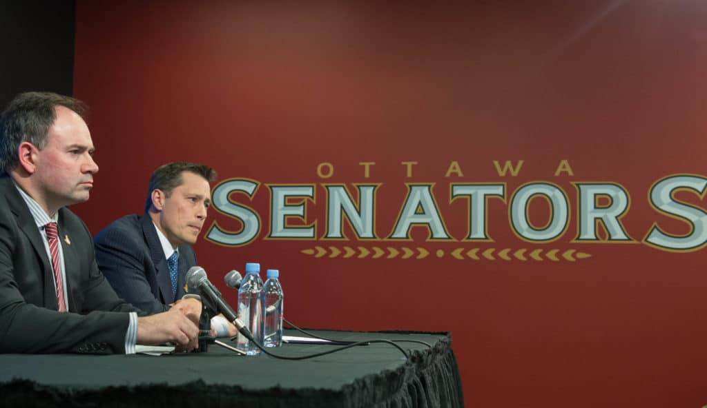 May 9, 2016; Ottawa, Ontario, CAN; Ottawa Senators general manager Pierre Dorion and new head coach Guy Boucher speak to the media at a press conference at the Canadian Tire Centre. Mandatory Credit: Marc DesRosiers-USA TODAY Sports