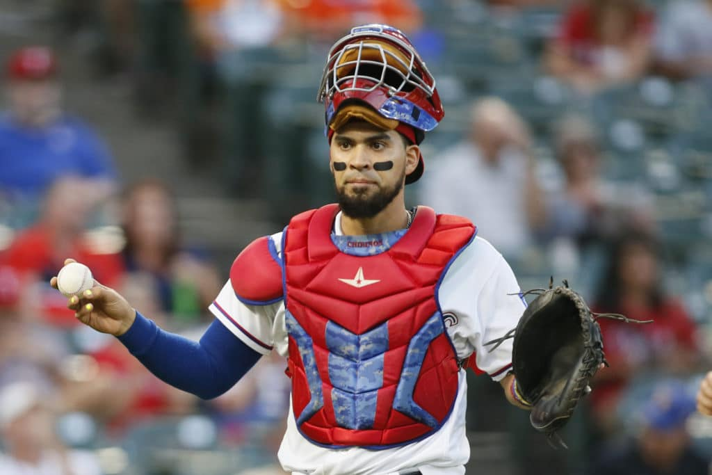 Sep 13, 2017; Arlington, TX, USA; Texas Rangers catcher Robinson Chirinos (61) reacts to a strike out in the first inning against the Seattle Mariners at Globe Life Park in Arlington. Mandatory Credit: Tim Heitman-USA TODAY Sports
