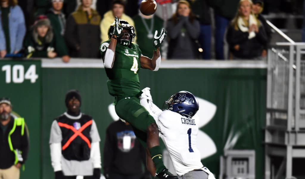 Oct 14, 2017; Fort Collins, CO, USA; Colorado State Rams wide receiver Michael Gallup (4) catches a touchdown reception over Nevada Wolf Pack defensive back Vosean Crumbie (1) in the first half at Sonny Lubrick Field at Colorado State Stadium. Mandatory Credit: Ron Chenoy-USA TODAY Sports