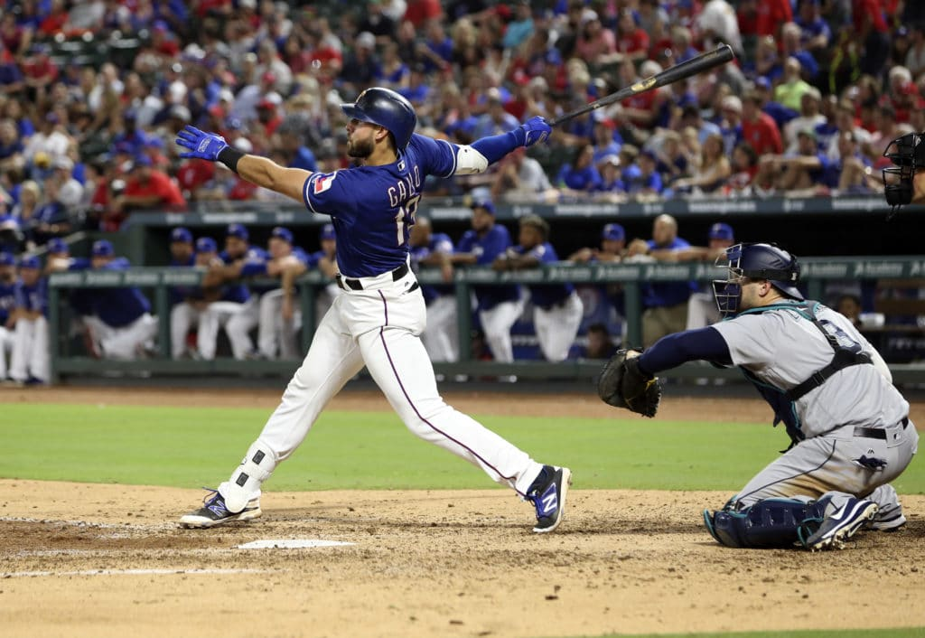 Sep 14, 2017; Arlington, TX, USA; Texas Rangers third baseman Joey Gallo (13) doubles during the fourth inning against the Seattle Mariners at Globe Life Park in Arlington. Mandatory Credit: Kevin Jairaj-USA TODAY Sports