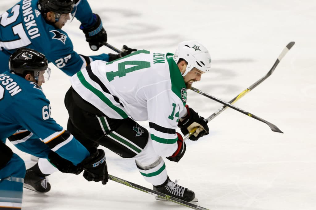 Feb 18, 2018; San Jose, CA, USA; Dallas Stars left wing Jamie Benn (14) fights for the puck against the San Jose Sharks in the third period at SAP Center at San Jose. Mandatory Credit: Kiel Maddox-USA TODAY Sports