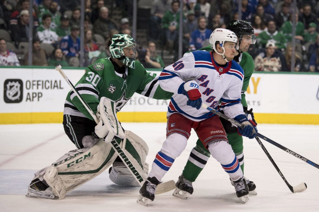 Feb 5, 2018; Dallas, TX, USA; Dallas Stars goalie Ben Bishop (30) and defenseman Dan Hamhuis (2) defend against New York Rangers right wing Michael Grabner (40) during the third period at the American Airlines Center. The Stars defeat the Rangers 2-1. Mandatory Credit: Jerome Miron-USA TODAY Sports