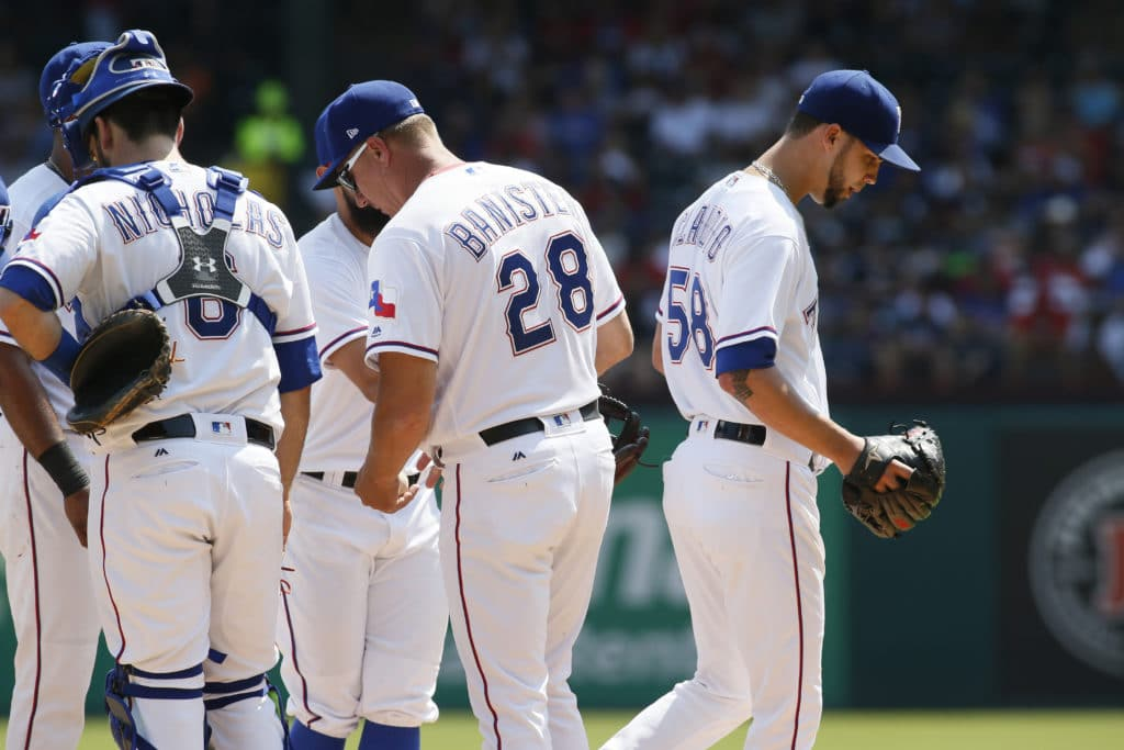 Sep 9, 2017; Arlington, TX, USA; Texas Rangers relief pitcher Alex Claudio (58) leaves the game after being relieved by manager Jeff Banister (28) in the ninth inning at Globe Life Park in Arlington. Mandatory Credit: Tim Heitman-USA TODAY Sports