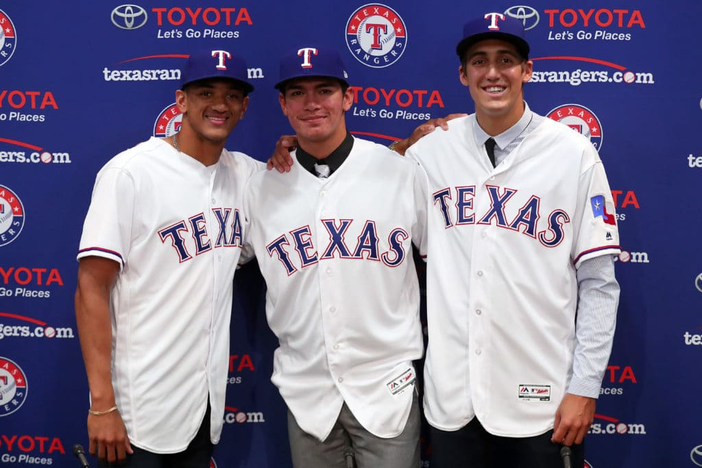 ARLINGTON, TX - JUNE 16:  (L-R) Bubba Thompson from McGill-Toolen High School, Chris Seise out of West Orange High School and right-handed pitcher Hans Crouse out of Dana Hills High School pose for a photo after the Texas Rangers announced the signings of several of the club's top selections in the 2017 Major League Baseball Draft at Globe Life Park in Arlington on June 16, 2017 in Arlington, Texas.  (Photo by Tom Pennington/Getty Images)