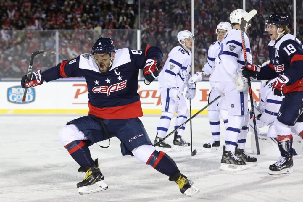 Mar 3, 2018; Annapolis, MD, USA; Washington Capitals left wing Alex Ovechkin (8) celebrates after scoring a goal on Toronto Maple Leafs goaltender Frederik Andersen (31) in the first period in a Stadium Series ice hockey game at Navy-Marine Corps Memorial Stadium. Mandatory Credit: Geoff Burke-USA TODAY Sports