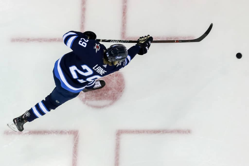 WINNIPEG, MB - FEBRUARY 20: Patrik Laine #29 of the Winnipeg Jets takes part in the pre-game warm up prior to NHL action against the Los Angeles Kings at the Bell MTS Place on February 20, 2018 in Winnipeg, Manitoba, Canada. (Photo by Jonathan Kozub/NHLI via Getty Images)