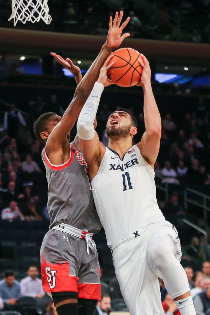 Mar 8, 2018; New York, NY, USA; Xavier Musketeers forward Kerem Kanter (11) shoots the ball as St. John's Red Storm guard Shamorie Ponds (2) defends during the second half in the Big East Conference tournament at Madison Square Garden. Mandatory Credit: Vincent Carchietta-USA TODAY Sports