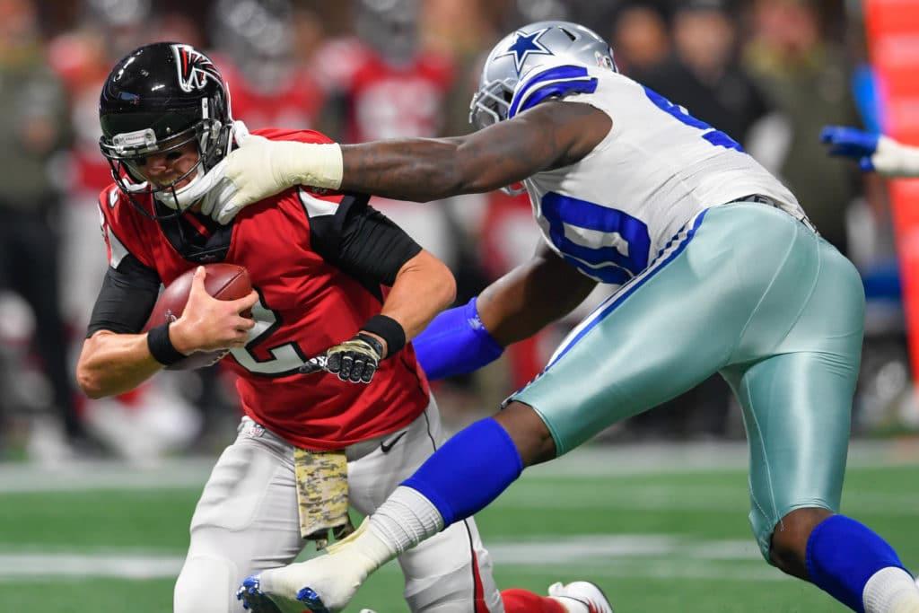 Nov 12, 2017; Atlanta, GA, USA; Atlanta Falcons quarterback Matt Ryan (2) is sacked by Dallas Cowboys defensive end DeMarcus Lawrence (90) during the first half at Mercedes-Benz Stadium. Mandatory Credit: Dale Zanine-USA TODAY Sports