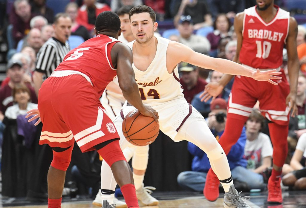 ST.  LOUIS, MO - MARCH 03: Loyola guard Ben Richardson (14) guards Bradley guard Darrell Brown Jr. (5) during a Missouri Valley Conference Basketball Tournament game between the Loyola Ramblers and the Bradley Braves on March 03, 2018, at Scottrade Center, St. Louis, MO.  (Photo by Keith Gillett/Icon Sportswire). (Icon Sportswire via AP Images)