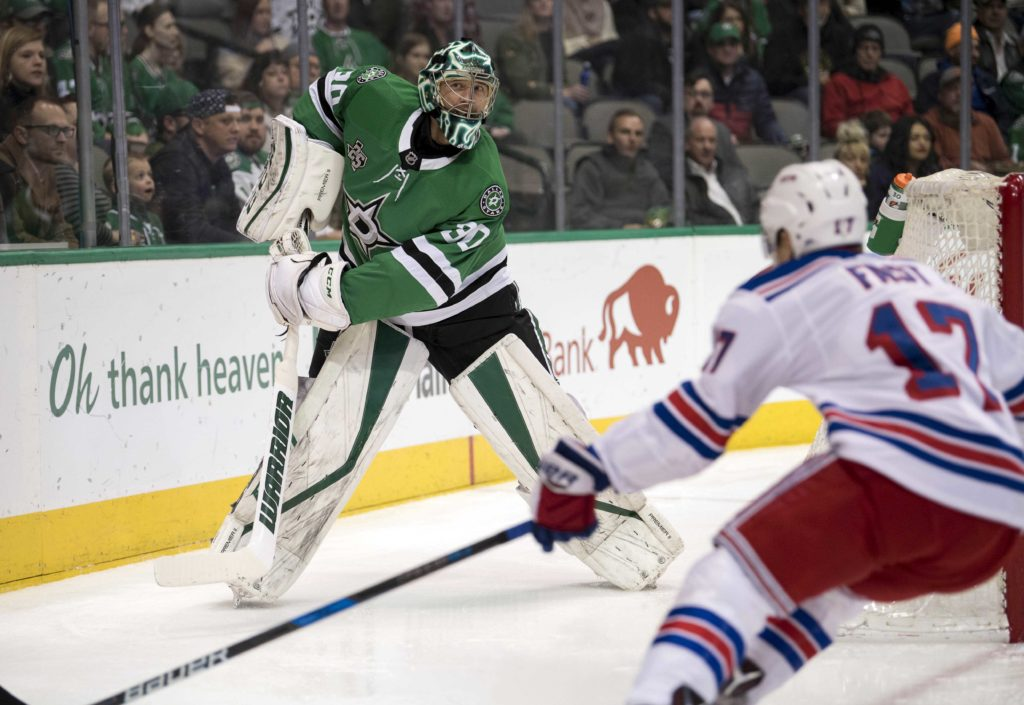 Feb 5, 2018; Dallas, TX, USA; Dallas Stars goalie Ben Bishop (30) clears the puck in front of New York Rangers right wing Jesper Fast (17) during the first period at the American Airlines Center. Mandatory Credit: Jerome Miron-USA TODAY Sports
