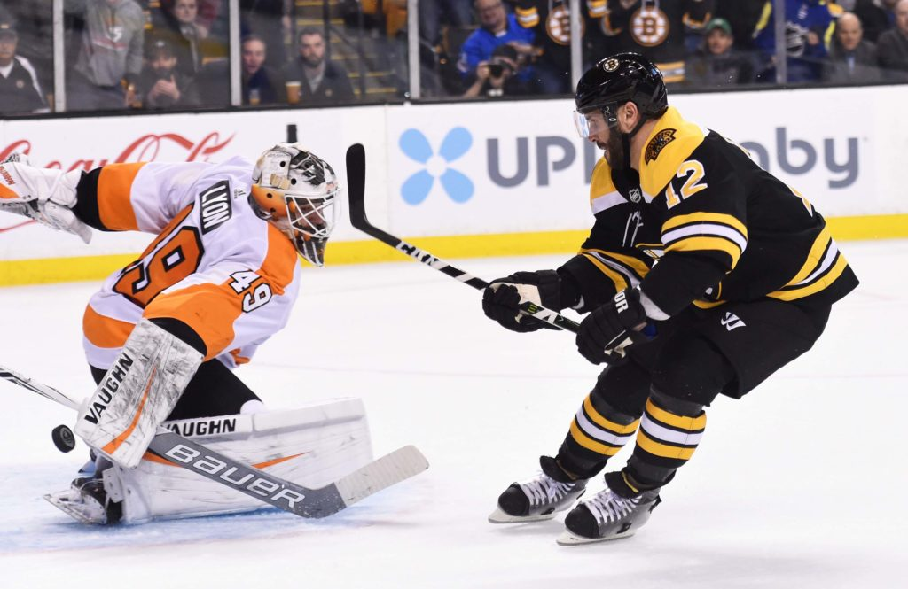 Mar 8, 2018; Boston, MA, USA; Boston Bruins right wing Brian Gionta (12) scores a goal past Philadelphia Flyers goaltender Alex Lyon (49) during the first period at TD Garden. Mandatory Credit: Bob DeChiara-USA TODAY Sports