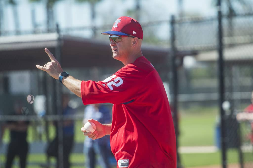 Phillies third base coach Dusty Walthan gives directions during infield practice as the Philidelphia Phillies gathered for their first full-team workout on Monday morning, February 19, 2018 at Spectrum Field in Clearwater, Florida.