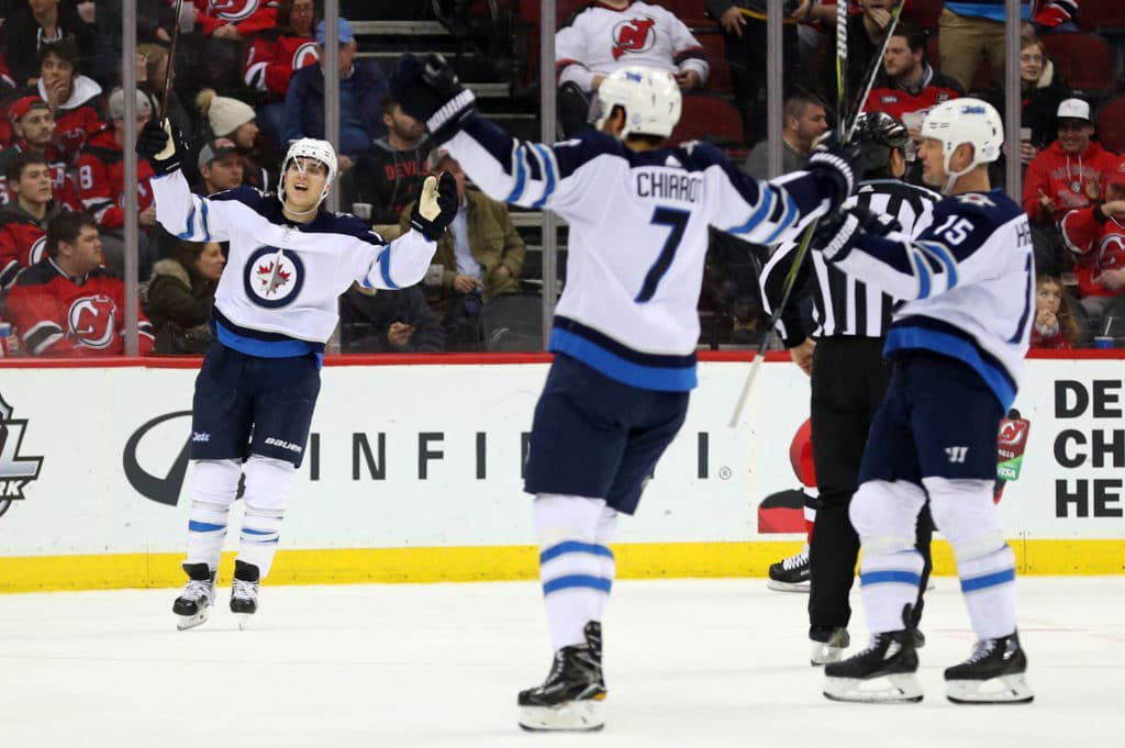 Mar 8, 2018; Newark, NJ, USA; Winnipeg Jets right wing Joel Armia (40) celebrates his goal during the second period of their game against the New Jersey Devils at Prudential Center. Mandatory Credit: Ed Mulholland-USA TODAY Sports