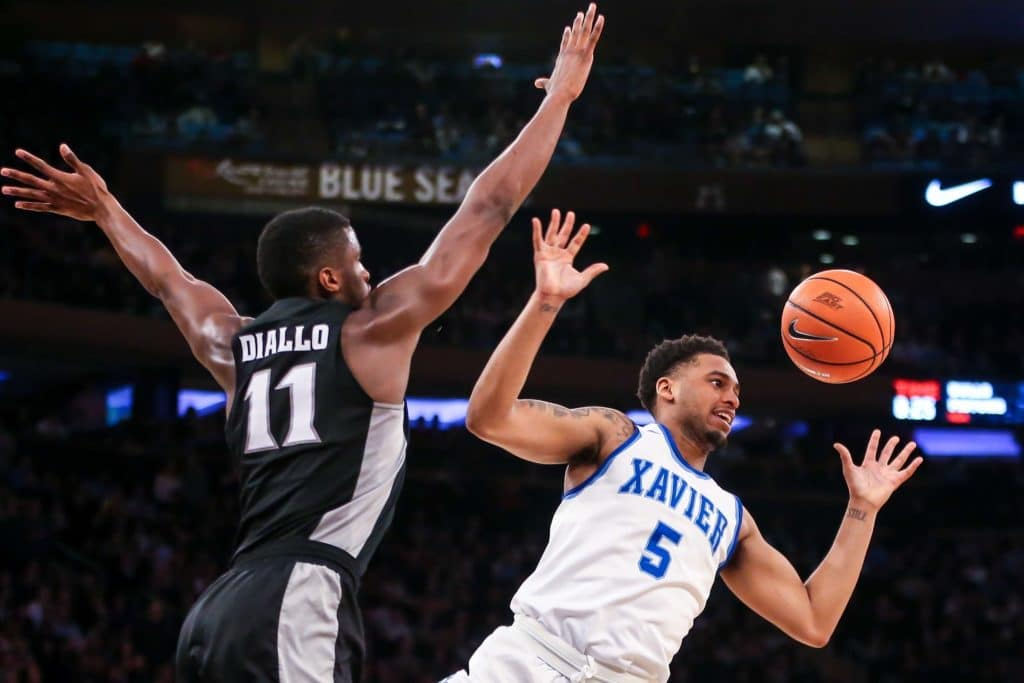 Mar 9, 2018; New York, NY, USA; Xavier Musketeers guard Trevon Bluiett (5) and Providence Friars guard Alpha Diallo (11) chase a loose ball during the overtime at Madison Square Garden. Mandatory Credit: Vincent Carchietta-USA TODAY Sports