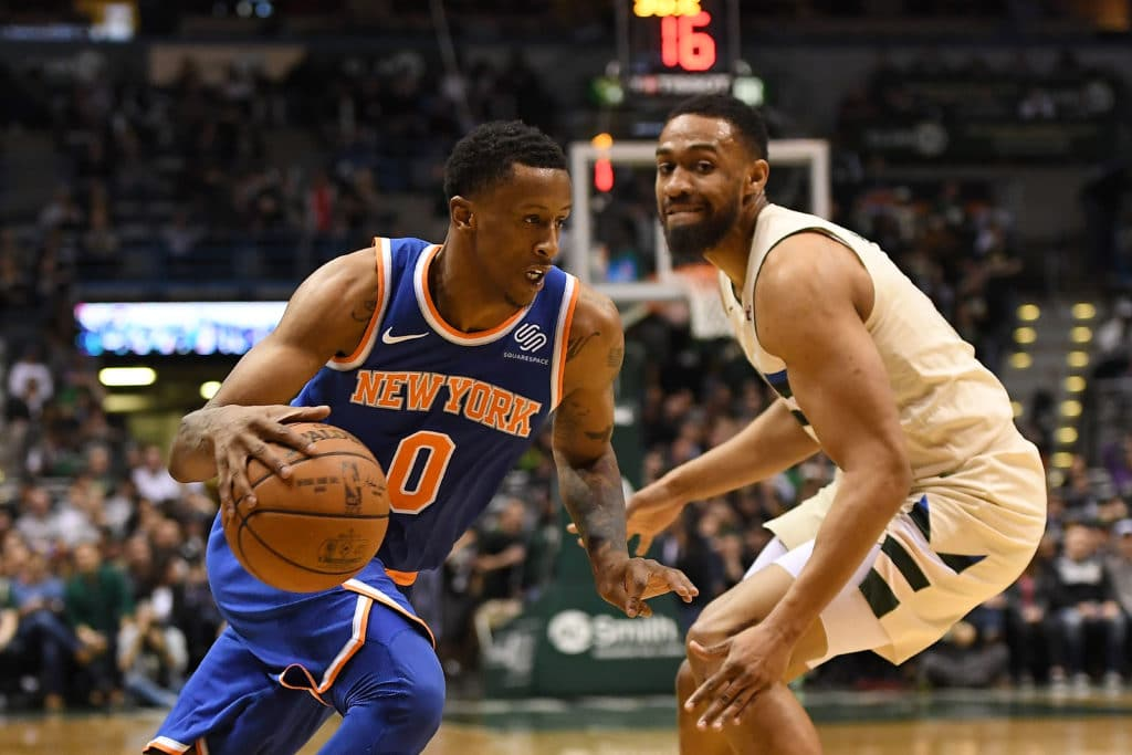 MILWAUKEE, WI - MARCH 09:  Troy Williams #0 of the New York Knicks drives around Jabari Parker #12 of the Milwaukee Bucks during the second half of a game at the Bradley Center on March 9, 2018 in Milwaukee, Wisconsin.  NOTE TO USER: User expressly acknowledges and agrees that, by downloading and or using this photograph, User is consenting to the terms and conditions of the Getty Images License Agreement.  (Photo by Stacy Revere/Getty Images)