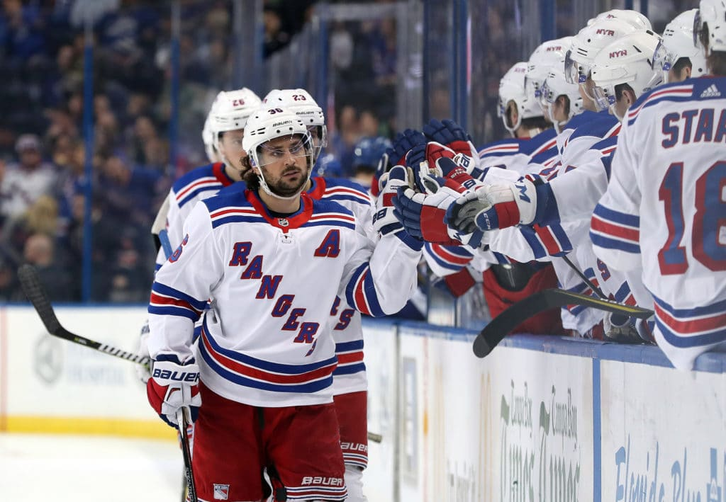 Mar 8, 2018; Tampa, FL, USA;New York Rangers right wing Mats Zuccarello (36) is congratulated as he scores a goal against the Tampa Bay Lightning during the third period at Amalie Arena. Mandatory Credit: Kim Klement-USA TODAY Sports