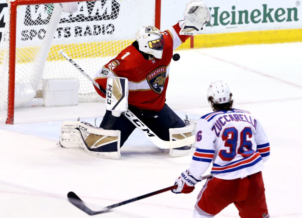 Mar 10, 2018; Sunrise, FL, USA;  Florida Panthers goalie Roberto Luongo (1) makes a save on a shot by New York Rangers right wing Mats Zuccarello (36) in overtime at BB&T Center. Mandatory Credit: Robert Mayer-USA TODAY Sports