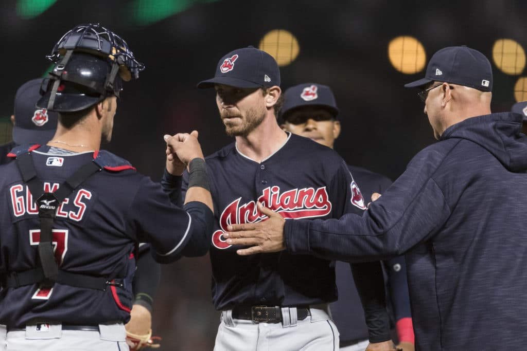 Jul 17, 2017; San Francisco, CA, USA; Cleveland Indians catcher Yan Gomes (7) fist pumps starting pitcher Josh Tomlin (43) as he is relieved by Cleveland Indians manager Terry Francona (17) in the eighth inning at AT&T Park. Mandatory Credit: John Hefti-USA TODAY Sports
