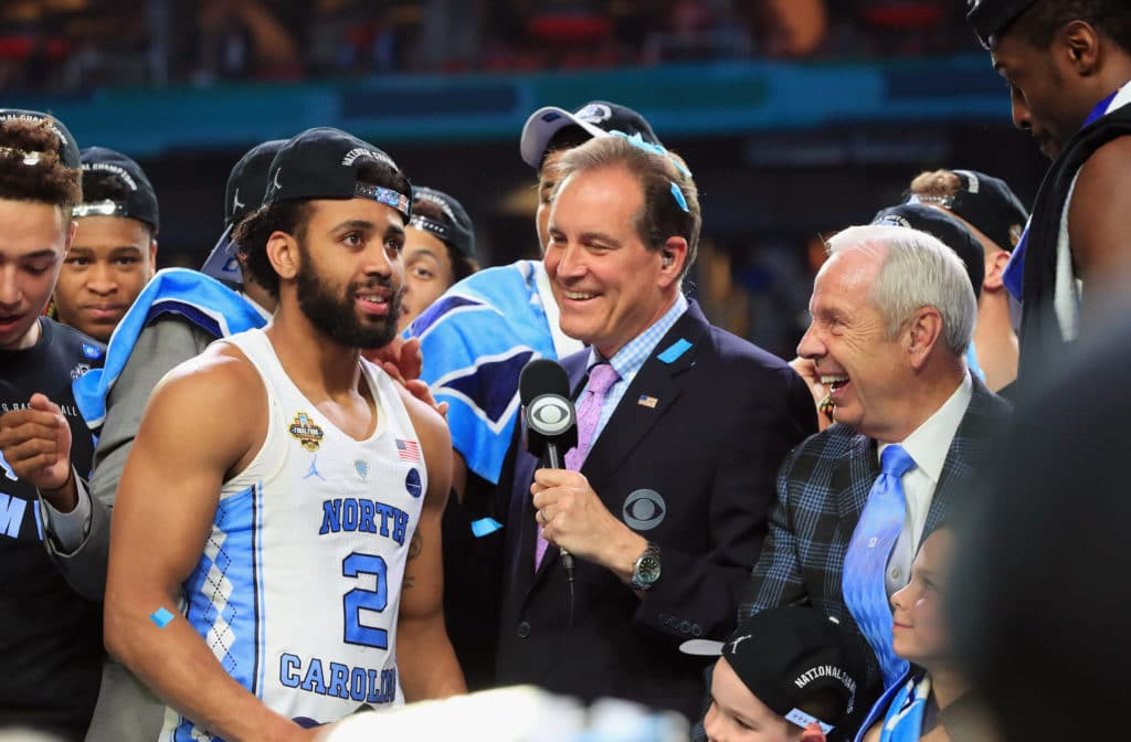 GLENDALE, AZ - APRIL 03:  TV personality Jim Nantz speaks to Most Outstanding Player Joel Berry II #2 of the North Carolina Tar Heels after defeating the Gonzaga Bulldogs during the 2017 NCAA Men's Final Four National Championship game at University of Phoenix Stadium on April 3, 2017 in Glendale, Arizona. The Tar Heels defeated the Bulldogs 71-65.  (Photo by Ronald Martinez/Getty Images)