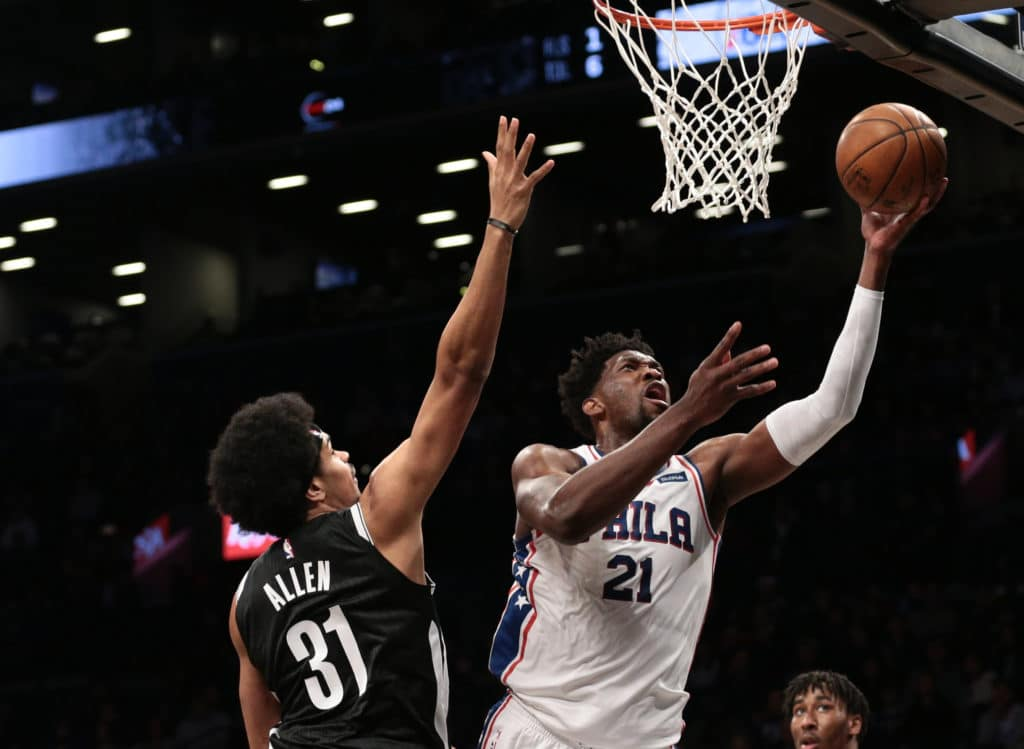 Mar 11, 2018; Brooklyn, NY, USA; Philadelphia 76ers center Joel Embiid (21) puts up a shot against Brooklyn Nets center Jarrett Allen (31) in the second quarter at Barclays Center. Mandatory Credit: Nicole Sweet-USA TODAY Sports