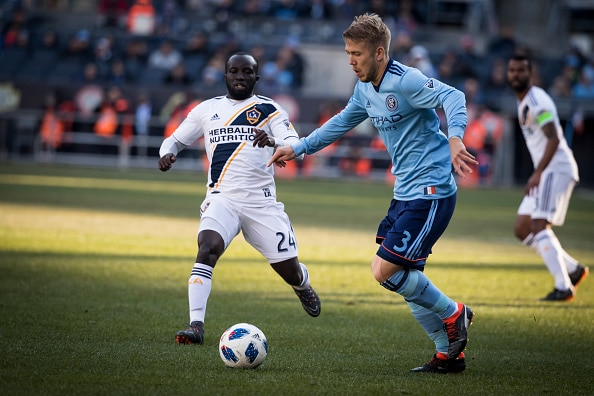BRONX, NY - MARCH 11: Anton Tinnerholm #3 of New York City keeps control of the ball against Ema Boateng #24 of Los Angeles Galaxy during the MLS Regular Season Home Opener between New York City FC and LA Galaxy at Yankee Stadium on March 11, 2018 in the Bronx borough of New York. New York City FC won the match with a score of 2 to 1.  (Photo by Ira L. Black/Corbis via Getty Images)