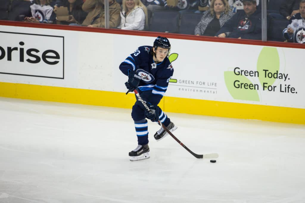 Sep 20, 2017; Winnipeg, Manitoba, CAN; Winnipeg Jets rookie defenseman Sami Niku (83) makes a pass against the Edmonton Oilers during the second period at Bell MTS Centre. Mandatory Credit: Terrence Lee-USA TODAY Sports