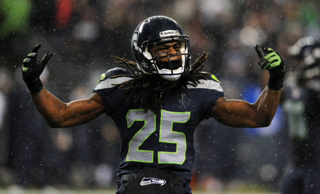 SEATTLE, WA. - DECEMBER 23: Cornerback Richard Sherman #25 of the Seattle Seahawks celebrates a tackle during the fourth quarter of the game against the San Francisco 49ers at CenturyLink Field on December 23, 2012 in Seattle,Wa. The Seahawks won the game 42-13. (Photo by Steve Dykes/Getty Images)