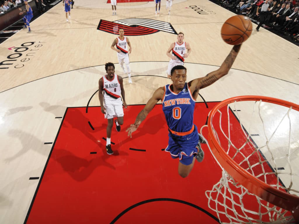 PORTLAND, OR - MARCH 6:  Troy Williams of the New York Knicks dunks against the Portland Trail Blazers on March 6, 2018 at the Moda Center in Portland, Oregon. NOTE TO USER: User expressly acknowledges and agrees that, by downloading and or using this Photograph, user is consenting to the terms and conditions of the Getty Images License Agreement. Mandatory Copyright Notice: Copyright 2018 NBAE (Photo by Cameron Browne/NBAE via Getty Images)