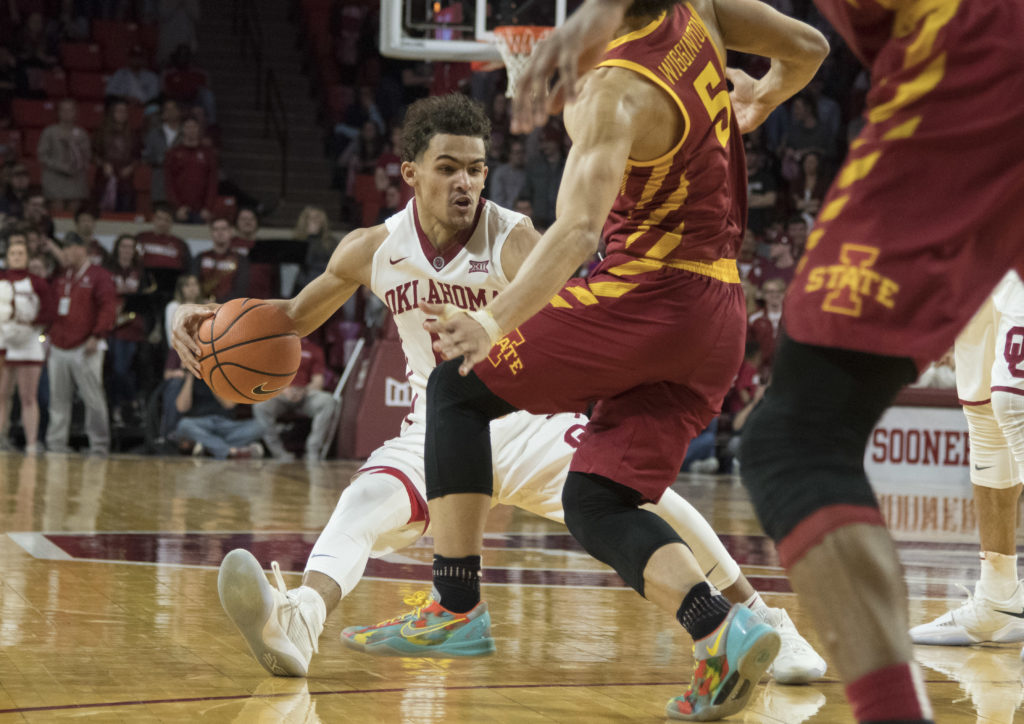 NORMAN, OK - MARCH 2:  Oklahoma Sooners guard Trae Young #11 slides into Iowa State Cyclones guard Lindell Wigginton #5 during the second half of a NCAA college basketball game at the Lloyd Noble Center on March 2, 2018 in Norman, Oklahoma. (Photo by J Pat Carter/Getty Images)