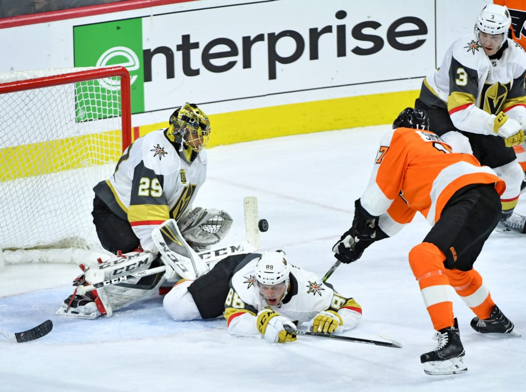 Mar 12, 2018; Philadelphia, PA, USA; Vegas Golden Knights goaltender Marc-Andre Fleury (29) makes a save with defenseman Nate Schmidt (88) against Philadelphia Flyers right wing Wayne Simmonds (17) during the third period at Wells Fargo Center. Mandatory Credit: Eric Hartline-USA TODAY Sports