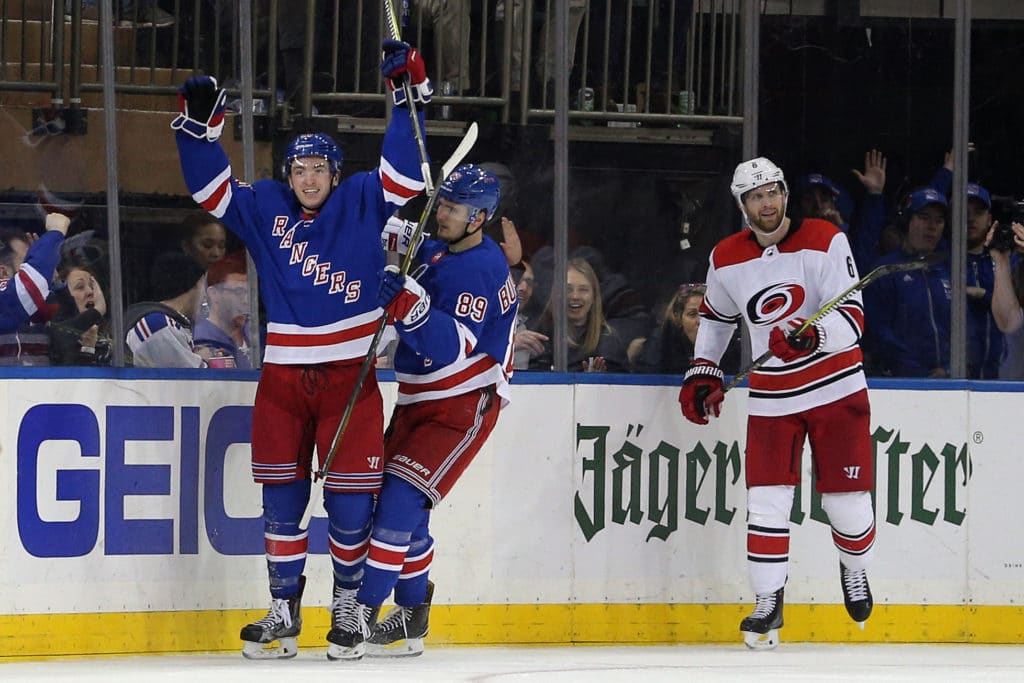 Mar 12, 2018; New York, NY, USA; New York Rangers left wing Jimmy Vesey (26) reacts with left wing Pavel Buchnevich (89) in front of Carolina Hurricanes defenseman Klas Dahlbeck (6) after scoring a goal during the third period at Madison Square Garden. Mandatory Credit: Brad Penner-USA TODAY Sports