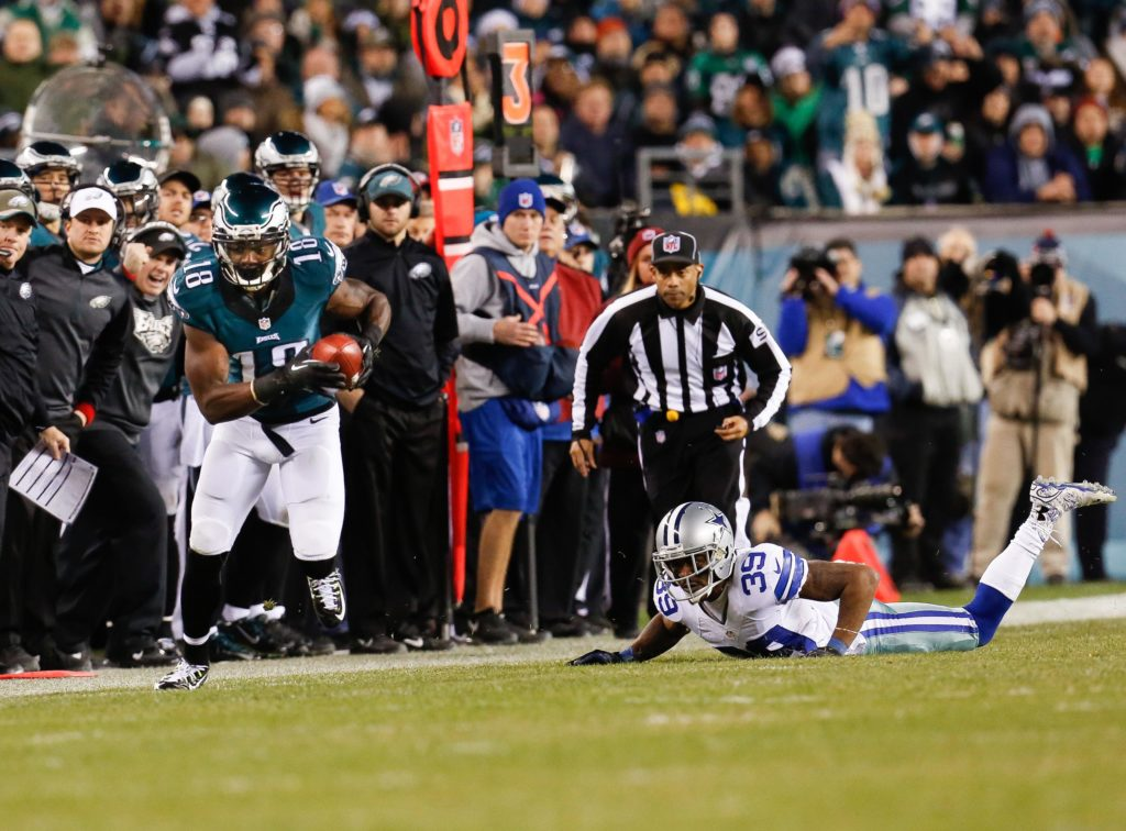 Dec 14, 2014; Philadelphia, PA, USA; Philadelphia Eagles wide receiver Jeremy Maclin (18) runs with the ball past the missed tackle of Dallas Cowboys cornerback Brandon Carr (39) at Lincoln Financial Field. The Cowboys defeated the Eagles 38-27. Mandatory Credit: Bill Streicher-USA TODAY Sports
