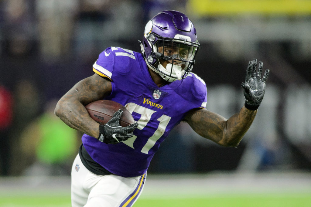 MINNEAPOLIS, MN - JANUARY 14: Jerick McKinnon #21 of the Minnesota Vikings carries the ball against the New Orleans Saints during the second half of the NFC Divisional Playoff game on January 14, 2018 at U.S. Bank Stadium in Minneapolis, Minnesota. (Photo by Hannah Foslien/Getty Images)