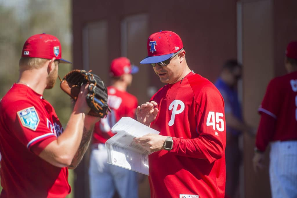 Phillies assistant pitching coach Chris Young talks to pitcher Ben Lively as the Philidelphia Phillies gathered for their first full-team workout on Monday morning, February 19, 2018 at Spectrum Field in Clearwater, Florida.