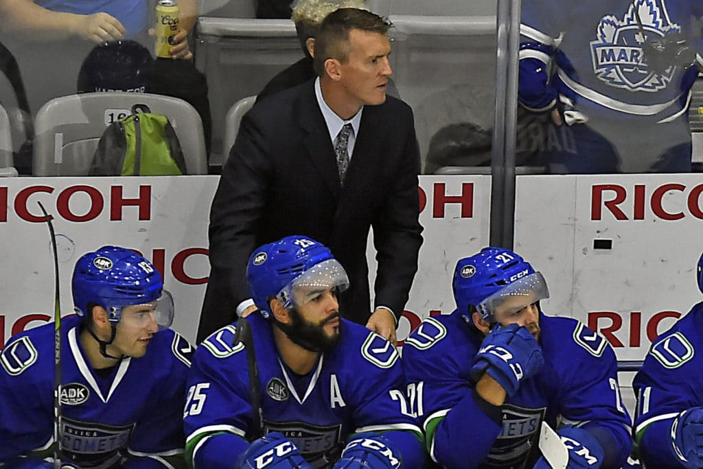 TORONTO, ON - OCTOBER 7: Head coach Trent Cull of the Utica Comets watches the play develop against the Toronto Marlies during AHL game action on October 7, 2017 at Ricoh Coliseum in Toronto, Ontario, Canada. (Photo by Graig Abel/Getty Images)