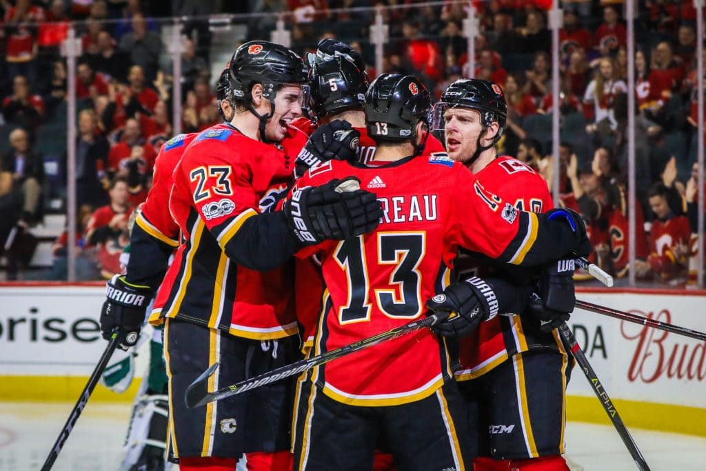 Oct 21, 2017; Calgary, Alberta, CAN; Calgary Flames right wing Kris Versteeg (10) celebrates his goal with teammates against the Minnesota Wild during the third period at Scotiabank Saddledome. Minnesota won 4-2. Mandatory Credit: Sergei Belski-USA TODAY Sports