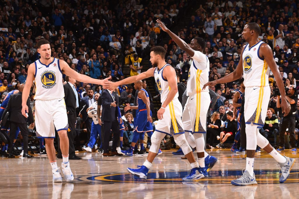 OAKLAND, CA - JANUARY 23: Klay Thompson #11 and Stephen Curry #30 of the Golden State Warriors high five during the game against the New York Knicks on January 23, 2018 at ORACLE Arena in Oakland, California. NOTE TO USER: User expressly acknowledges and agrees that, by downloading and/or using this photograph, user is consenting to the terms and conditions of Getty Images License Agreement. Mandatory Copyright Notice: Copyright 2018 NBAE (Photo by Noah Graham/NBAE via Getty Images)