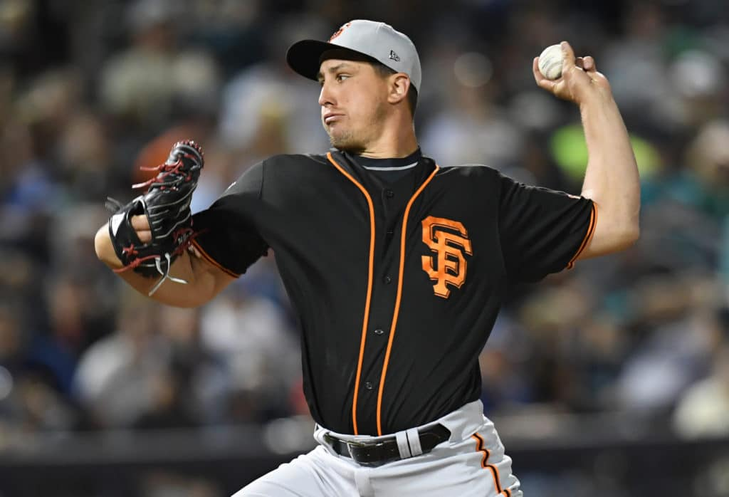 Mar 8, 2018; Peoria, AZ, USA; San Francisco Giants starting pitcher Derek Holland (45) pitches against the Seattle Mariners during the fourth inning at Peoria Sports Complex. Mandatory Credit: Joe Camporeale-USA TODAY Sports