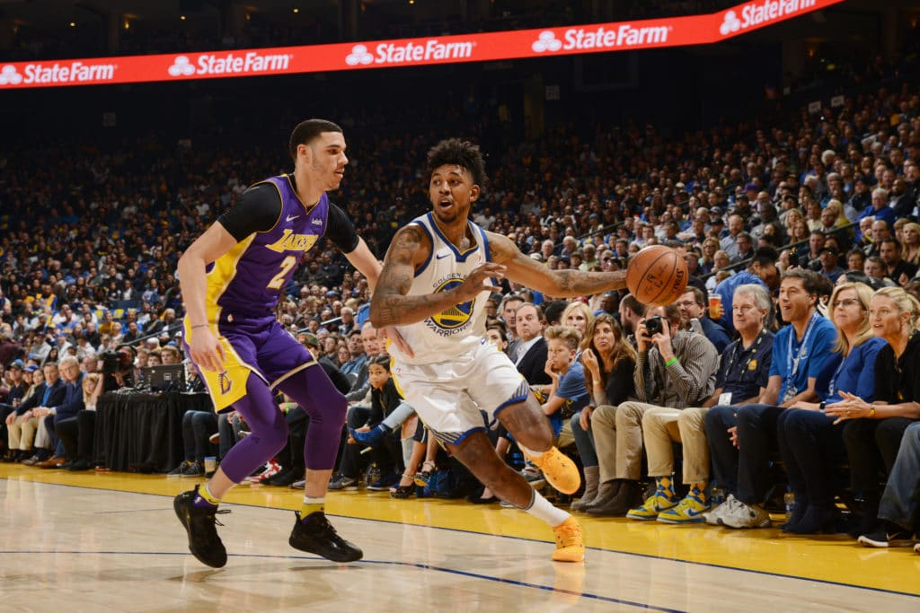 OAKLAND, CA - MARCH 14:  Nick Young #6 of the Golden State Warriors handles the ball against Lonzo Ball #2 of the Los Angeles Lakers on March 14, 2018 at ORACLE Arena in Oakland, California. NOTE TO USER: User expressly acknowledges and agrees that, by downloading and or using this photograph, user is consenting to the terms and conditions of Getty Images License Agreement. Mandatory Copyright Notice: Copyright 2018 NBAE (Photo by Noah Graham/NBAE via Getty Images)