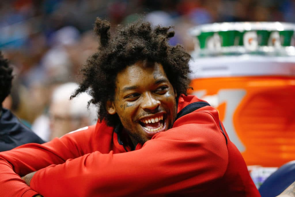 Feb 11, 2018; Charlotte, NC, USA; Toronto Raptors center Lucas Nogueira (92) laughs on the bench during the second half against the Charlotte Hornets at Spectrum Center. Mandatory Credit: Jeremy Brevard-USA TODAY Sports