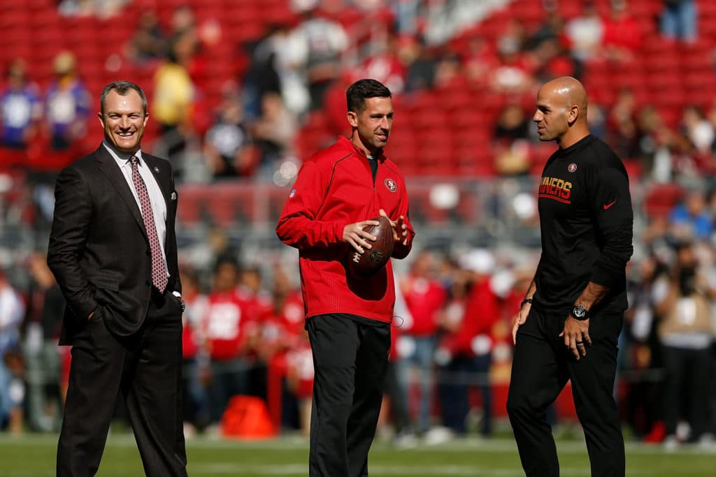 SANTA CLARA, CA - NOVEMBER 05: San Francisco 49ers General Manager John Lynch, Head Coach Kyle Shanahan and Defensive Coordinator Robert Saleh look on during the warm up before the game against the Arizona Cardinals at Levi's Stadium on November 5, 2017 in Santa Clara, California. (Photo by Lachlan Cunningham/Getty Images)