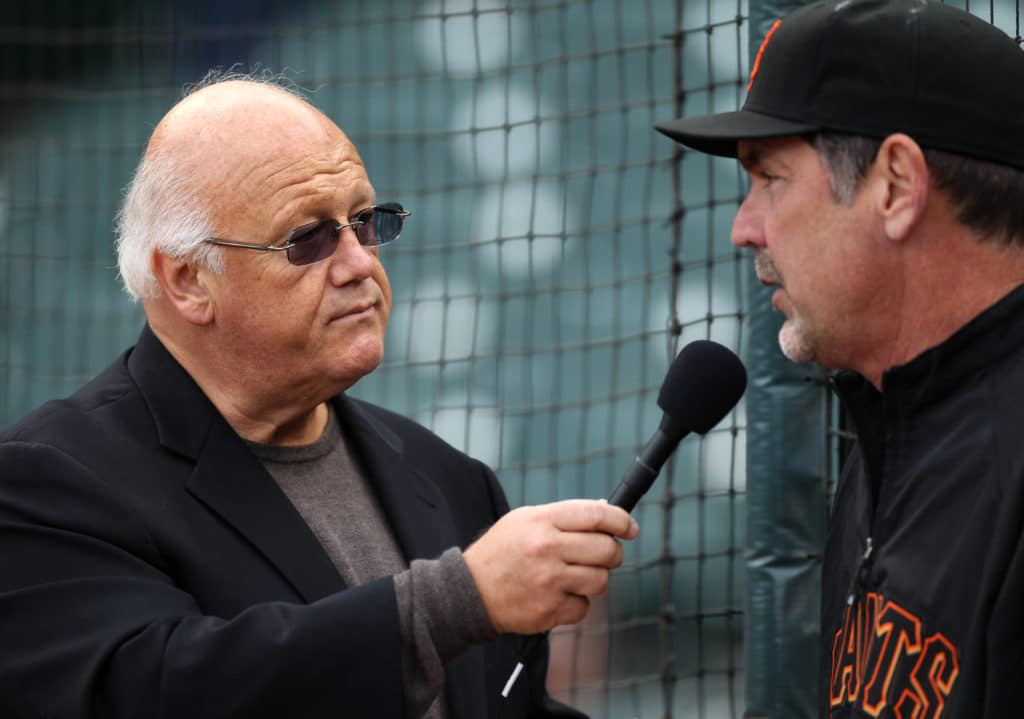 SAN FRANCISCO - APRIL 26:  San Francisco Giants radio broadcaster Jon Miller (L) interviews San Francisco Giants manager Bruce Bochy #15 before the game between the Philadelphia Phillies and the San Francisco Giants at AT&T Park on April 26, 2010 in San Francisco, California. (Photo by Brad Mangin/MLB Photos via Getty Images)