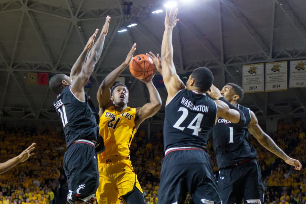 Mar 4, 2018; Wichita, KS, USA; Wichita State Shockers forward Darral Willis Jr. (21) tries to put up a shot guarded by Cincinnati Bearcats forward Gary Clark (11) and Cincinnati Bearcats forward Kyle Washington (24) and Cincinnati Bearcats guard Jacob Evans (1) during the 2nd half of the AAC conference mens basketball game at Charles Koch Arena. Mandatory Credit: William Purnell-USA TODAY Sports